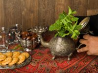 56372425 - hands of a muslim woman preparing mint tea the traditional way